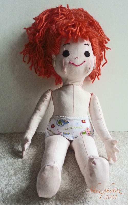 The doll has a face and underwear.