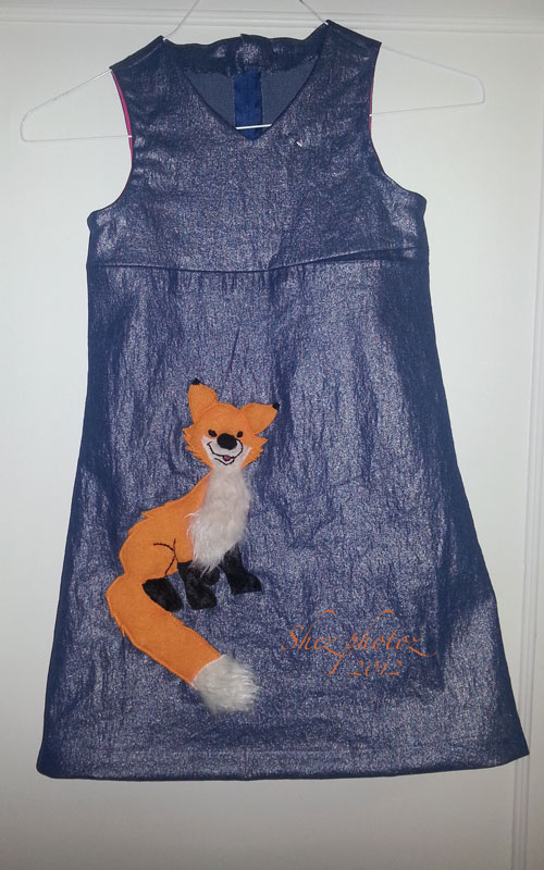 Blue denim dress with a red fox applique.