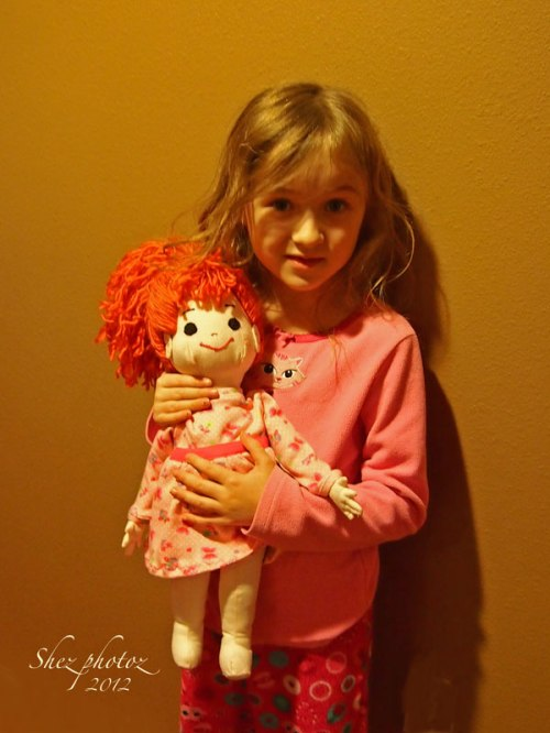 Little girl with doll.